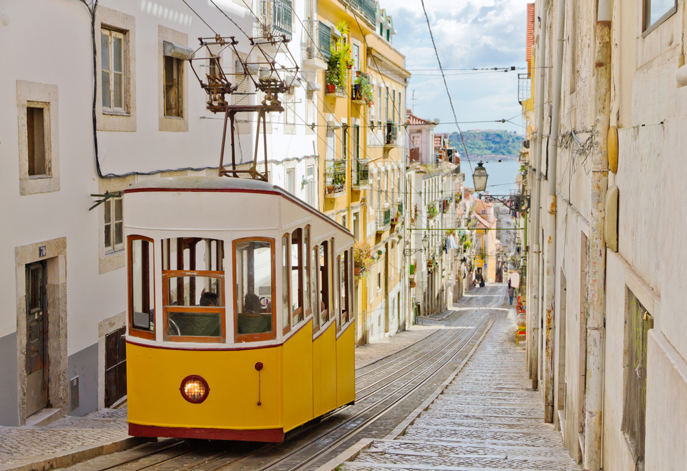 The steep streets of Lisbon, Portugal are reminiscent of San Francisco, and the colorful street cars enhance that image